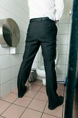 stock photo of peeing  - Man peeing in toilet - JPG