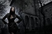 image of sorcery  - Fashion shoot of young and sexy brunette over the ancient building background - JPG