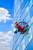 stock photo of hamlet  - Window washer at work and reflect the sky in the windows - JPG