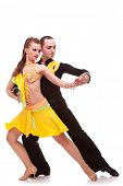 stock photo of jive  - beautiful salsa dancing couple in the active ballroom dance in a splendid dance pose - JPG