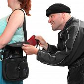 stock photo of delinquency  - Thief stealing from handbag of a woman - JPG