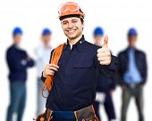 stock photo of petrol  - Portrait of an happy worker in front of his team - JPG