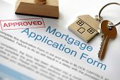 stock photo of key  - Approved Mortgage loan application with house key and rubber stamp - JPG
