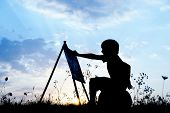 picture of masterpiece  - Little boy artist drawing and painting in nature - JPG