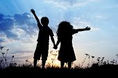 stock photo of little sister  - Little brother and sister silhouette - JPG