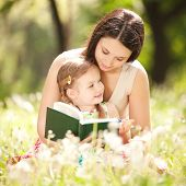 picture of cuddling  - Mother with daughter in the park - JPG