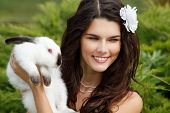 picture of alice wonderland  - Young woman bride smiling and holding ute rabbit over park summer nature outdoor - JPG
