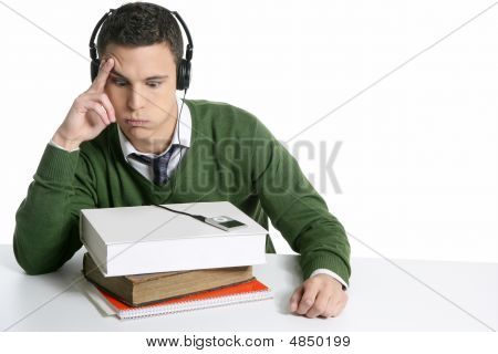 Young Student Boy With Books On Desk