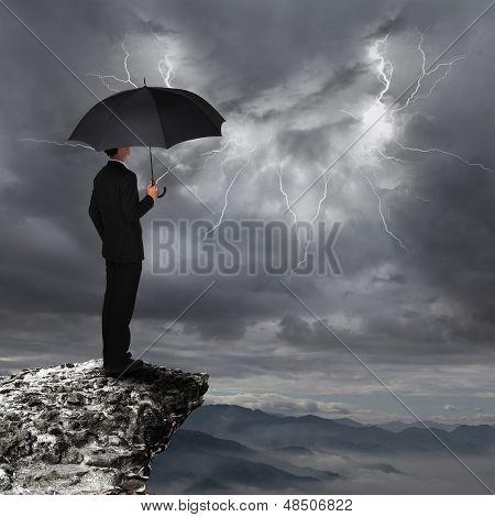 Business Man With Umbrella Look Rainstorm Cloud