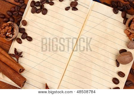 old paper for recipes and spices on wooden table
