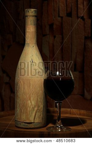 Composition with old bottle of wine and wineglass in old cellar, on dark  background