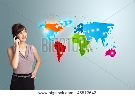 Beautiful young woman making phone call with colorful world map