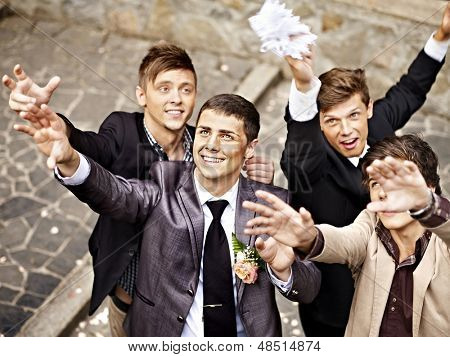 Group men catch  bride  garter. Wedding.