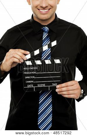Cropped Image Of Man With Clapboard