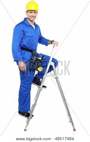 Construction Worker Climbing Up The Stepladder