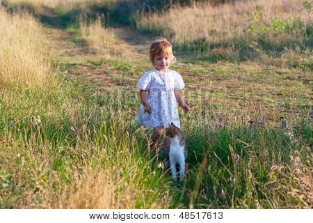 Little Girl In The Light Dress With Cat