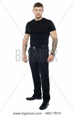 Strong Male Bouncer. Tattoo On Both His Hands