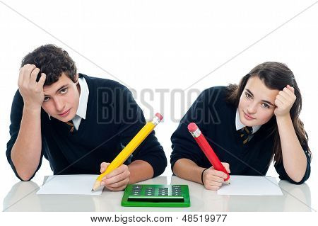 Confused Students Holding Their Heads During Examination