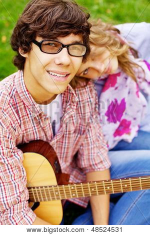 Romantic teen couple in park