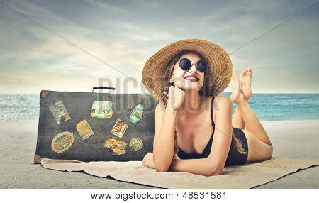 beautiful woman sunbathing at the beach