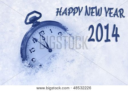 Pocket watch in snow Happy New Year 2014 greeting card
