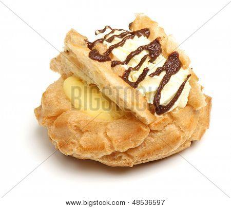 Choux pastry bun with fresh cream, custard and chocolate