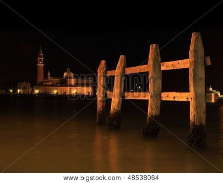 Mooring Posts in a Venetian canal at night