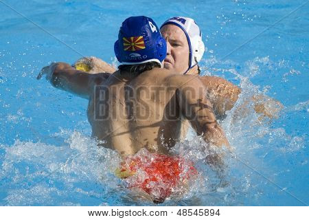 Jul 22 2009; Rome Italy; Dimitar Dimovski playing in the blue hat and Ronald Beaubien USA team player playing  in the 13th Fina World Aquatics Championships