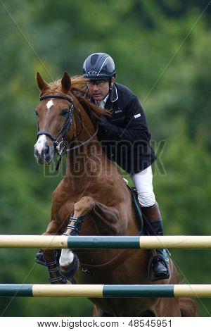 25/06/2011 HICKSTEAD ENGLAND, MURKAS NEVADA ridden by Peter  Charles (GBR) competing in the Falcon Equine Feeds Derby Trophy at the Hickstead Equestrian meeting held at Hickstead West Sussex England