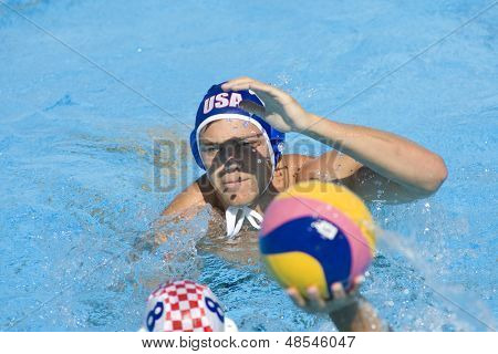 Jul 01 2009; Rome Italy; USA team player Timothy Hutten defends a ball from Andro Buslje (CRO)  at the 13th Fina World Aquatics Championships held in the The Foro Italico Swimming Complex.