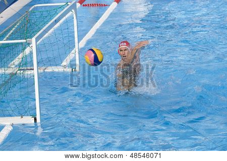 Jul 22 2009; Rome Italy; Merrill Moses USA team player saves a shot while competing preliminary round waterpolo match between USA and Macedonia in the 13th Fina World Aquatics Championships
