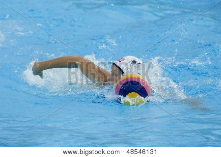Jul 23 2009; Rome Italy; Alison Gregorka (USA) swimming with the ball while competing in the  waterpolo competition between USA and Greece at the 13th Fina World Aquatics Championships