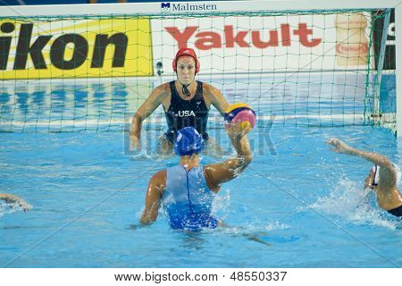 Jul 23 2009; Rome Italy; Elizabeth Armstrong (USA) and Angelika Gerolimou (GRE) while competing in the waterpolo match between USA and Greece at the 13th Fina World Aquatics Championships