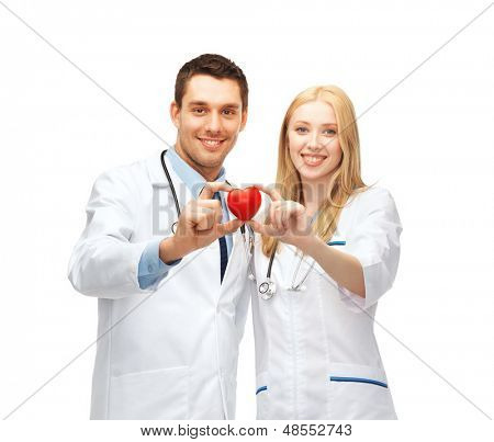 healthcare and medical concept - two young doctors cardiologists with heart