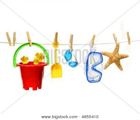 Child's Summer Toys On Clothesline Against White