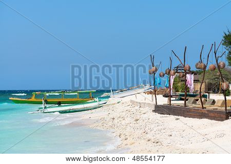 Small Wooden Long Boats On Blue Sea
