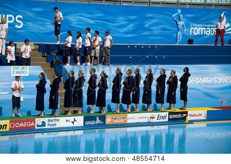 Jul 22 2009; Rome Italy; USA team players salute their national anthem prior to competing preliminary round waterpolo match between USA and Macedonia in the 13th Fina World Aquatics Championships
