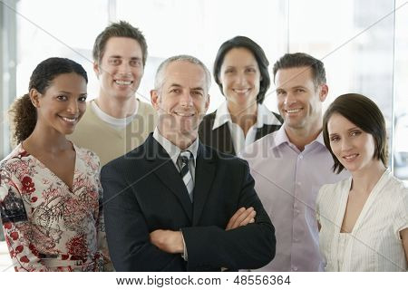 Group of multiethnic business people smiling in office