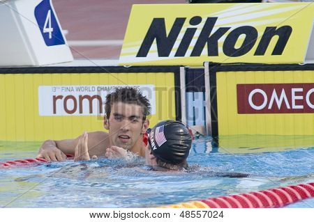 Jul 29 2009; Rome Italy; Michael Phelps (USA) is congratulated by team mate Scott Clary after winning the 200m butterfly final the race was won by Michael Phelps USA in a world record time of1.51.51
