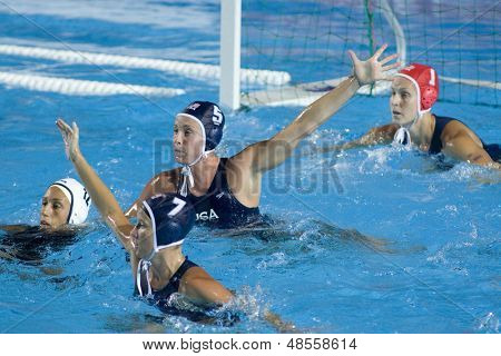 Jul 31 2009; Rome Italy; USA team players Kelly Rulon (7)  Lauren Wenger (5)  goalkeeper Elizabeth Armstrong competing in the final of the womens waterpolo tournament, USA won the match 7-6,