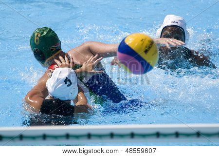 Jul 23 2009; Rome Italy; Joelle Bezhaki (CAN) pushes Sarah Harris (RSA) while competing in the  waterpolo match between Canada and South Africa in the 13th Fina World Aquatics Championships