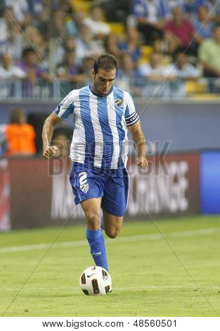 MALAGA, SPAIN. 19/09/2010.  Jesus G�?�?�?�¡mez the Malaga defender runs with the ball during the La Liga match between CF Malaga and Sevilla, played in the La Rosaleda Stadium