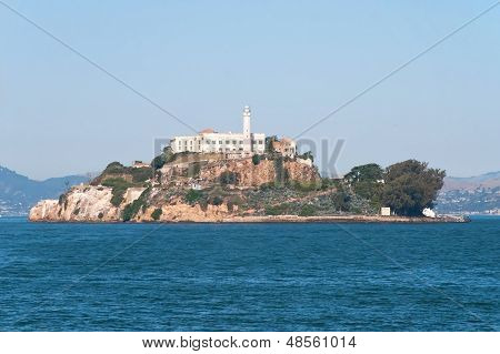 Alcatraz Jail Island In San Francisco Bay With A Beautiful Blue Sky In Background