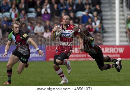 17/09/2011. Twickenham, England.  Gloucester's Charlie Sharples,  is tackled by Harlequins Ugo Monye, during the Aviva premiership rugby union match between Harlequins and Gloucester