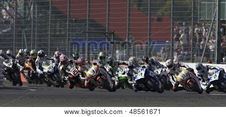 27 Sept 2009; Silverstone England: Rider number 7 James Ellison (GBR) leads the pack into the first turn of race 1 of round 11,  at the MCE Insurance British Superbike Championship: