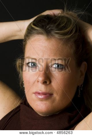Attractive Blond Middle Age Woman With Hair Up