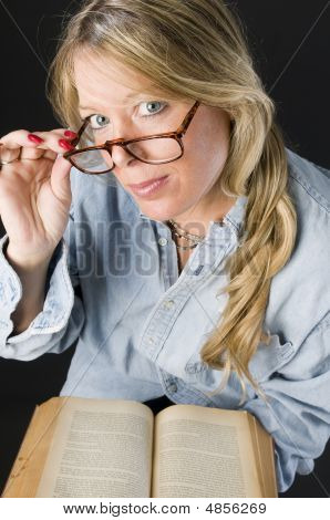 Pretty Attractive Blond Woman Close Up Reading Glasses Book