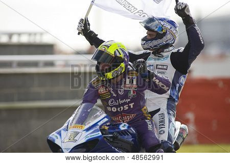 27 Sept 2009; Silverstone England: Rider number 2 Leon Camier (GBR) gets a lift back to the pits after winning by former champion Nial Mckenzie,  at the MCE Insurance British Superbike Championship: