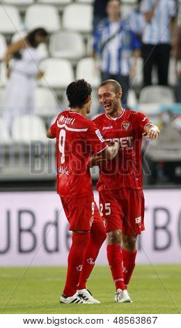 MALAGA, SPAIN. 19/09/2010.  Diego Perotti a Sevilla midfield player and Tiberio Guarente a Sevilla midfield player celebrate winning the La Liga match between CF Malaga and Sevilla 2-1,