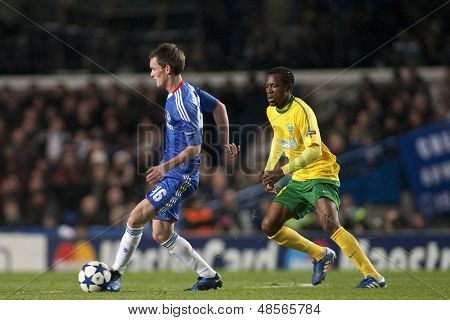 LONDON ENGLAND 23-11-2010. Chelsea's midfielder Josh McEachran and MSK Zilina's forward Bello in action during the UEFA Champions League group stage match between Chelsea FC and MSK Zilina